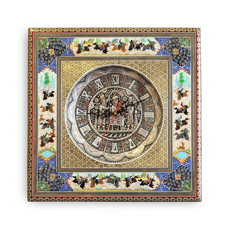 A contemporary wall clock made from a combination of arts. The middle circle is in scrimshaw, the middle square in Khatamkari, and the horsemen in white and blue background is Minakari.