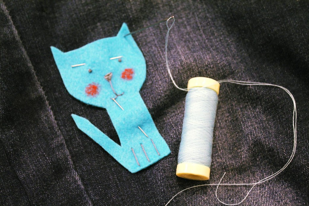 20 - pinning kitty on pants